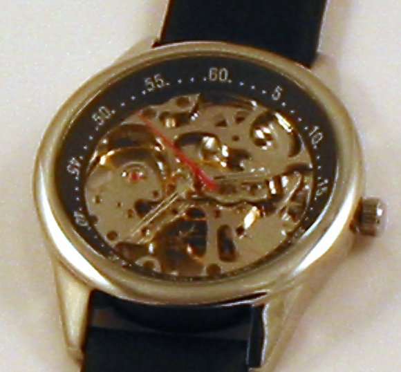 Mechanical (wind up),17 Jewels, no batteries required, see thru skeleton, natural leather black band,running time per winding no less than 38 hours, 3 hands, watch case measures 1.5 inches in diameter, length with band is 9 3/4 inches, MIN ORDER -200 watches. Delivery time - 75 days